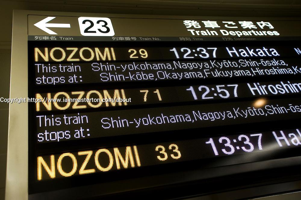 Detail of information board showing bullet train departures at Tokyo Station in Japan