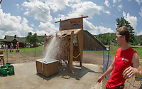 """Tony Delgado watches as an incoming water balloon makes a direct hit on its target Thursday afternoon at Gunstock Mountain Resort's new """"Water Wars"""" adventure.  (Karen Bobotas/for the Laconia Daily Sun)"""