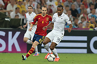FOOTBALL - UEFA EURO 2012 - DONETSK - UKRAINE  - 1/4 FINAL - SPAIN v FRANCE - 23/06/2012 - PHOTO PHILIPPE LAURENSON /  DPPI - ANDRES INIESTA (ESP) / FLORENT MALOUDA (FRA)