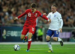 06.09.2011, Wembley Stadium, London, GBR, UEFA EURO 2012, Qualifikation, England vs Wales, im Bild Wales' Aaron Ramsey and England's Wayne Rooney during the UEFA Euro 2012 Qualifying Group G match at Wembley Stadium on 6/9/2011. EXPA Pictures © 2011, PhotoCredit: EXPA/ Propaganda Photo/ Chris Brunskill +++++ ATTENTION - OUT OF ENGLAND/GBR+++++