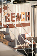 Modern Beach bar with brown letter writing on panel wall, Cannes, France