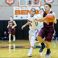 Gallup Bengal Quincy Smith (20), left,  attempts a steal on Belen Eagle Omar Rojo (4) at Gallup High School Saturday.