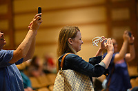 Parents photographing their children meeting Disney Princesses and enjoying a sing along with them during the Ravenwood Royal Experience at Ravenwood High School Saturday, March 30, 2019.  The event is a fundraiser for St Jude Children's Hospital and the Ravenwood Theatre Department. Photo Harrison McClary/News & Observer