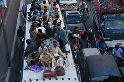 September 1, 2017 - Lahore, Punjab, Pakistan - People on-board a train,buses going home to celebrate 'Eid al-Adha' with their loved ones. Muslims around the world start preparing for 'Eid al-Adha', a festival to sacrifice cattle, goats and sheep in commemoration of the Prophet Abraham's readiness to sacrifice his son and to show his obedience to God. The festival marks the end of Hajj where millions of Muslims perform the annual pilgrimage to Mecca. (Credit Image: © Rana Sajid Hussain/Pacific Press via ZUMA Wire)