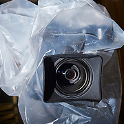 A television camera is protected from rain outside the Manhattan Criminal Court, Jan 16, 2020.