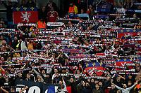 Football - 2018 / 2019 UEFA Champions League - Group F: Manchester City vs. Olympique Lyonnais<br /> <br /> Olympique Lyonnais fans hold their scarves aloft, at the Etihad Stadium.<br /> <br /> COLORSPORT/PAUL GREENWOOD