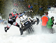 PRICE CHAMBERS / NEWS&GUIDE<br /> David Sharp of Moxee, Wash. balances his sled with his body weight as he races to the top of Snow King's Exhibition run on Sunday at the World Championship Snowmobile Hillclimb.