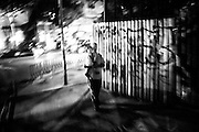September 2015. Thessaloniki. A man walking on the streets with his daughter on his arms.