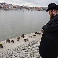 A participant of the Rabbinical Centre of Europe conference attends a remembrance on the 70th anniversary of the Holocaust in Budapest, Hungary on March 24, 2014. ATTILA VOLGYI