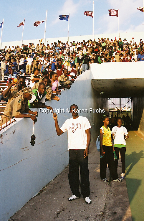 Usain Bolt with his brother at Boys and Girls Highschool Champs in Kingston Jamaica March'05