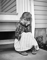 July 21, 2019 - Portrait Of Girl Sitting On Porch (Credit Image: © Ron Nickel/Design Pics via ZUMA Wire)