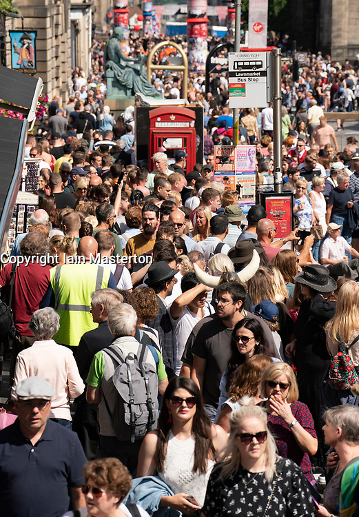 Edinburgh, Scotland, UK. 4 August 2019. On the first weekend of the Edinburgh Fringe Festival good weather brought out thousands of tourists to enjoy the many street performers  on the Royal Mile in Edinburgh Old Town. Iain Masterton/Alamy Live News