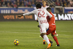 March 1, 2018 - Harrison, New Jersey, United States - Carlos Mejia (7) of CD Olimpia of Honduras & Michael Murillo (62) of New York Red Bulls fights for ball during 2018 CONCACAF Champions League round of 16 game at Red Bull arena, Red Bulls won 2 - 0  (Credit Image: © Lev Radin/Pacific Press via ZUMA Wire)