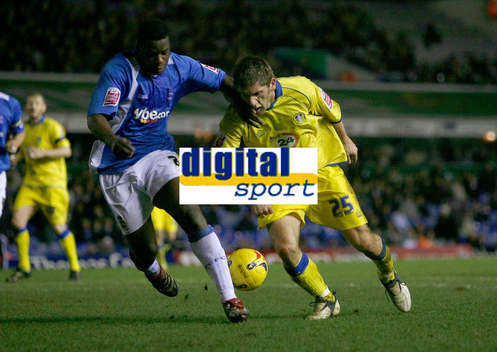 Leeds attacker Richard Cresswell (right) attacks Birmingham defender Bruno N'Gotty