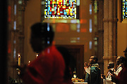 """Rev. David Jones leads Chicago Catholic School students in the Lord's Prayer during the 33rd Annual African American Heritage Month Mass at Holy Name Cathedral. This year's mass celebrates the the Nguzo Saba principle of Kuumba, or """"creativity"""" at Holy Name Cathedral."""