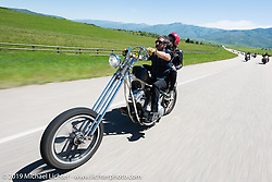 Buck Chavarria of Steamboat Springs, CO and pastor of SK8 Church with daughter Chloe on his Sportster chopper riding the 20 Mile Road in Steamboat Springs during the Rocky Mountain Regional HOG Rally, Colorado, USA. Saturday June 10, 2017. Photography ©2017 Michael Lichter.
