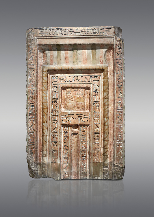 Ancient Egyptian False Door stele of Chamberlain Hornakht, son of Mera, slimestone, Middle Kingdom, 12th Dynasty (1939-1759 BC),  Egyptian Museum, Turin. Old fund cat 1612.  Grey background<br /> <br /> A false door is an artistic representation of a door which does not function like a real door. They can be carved in a wall or painted on it. They are a common architectural element in the tombs of ancient Egypt, .<br /> <br /> If you prefer to buy from our ALAMY PHOTO LIBRARY  Collection visit : https://www.alamy.com/portfolio/paul-williams-funkystock/ancient-egyptian-art-artefacts.html  . Type -   Turin   - into the LOWER SEARCH WITHIN GALLERY box. Refine search by adding background colour, subject etc<br /> <br /> Visit our ANCIENT WORLD PHOTO COLLECTIONS for more photos to download or buy as wall art prints https://funkystock.photoshelter.com/gallery-collection/Ancient-World-Art-Antiquities-Historic-Sites-Pictures-Images-of/C00006u26yqSkDOM