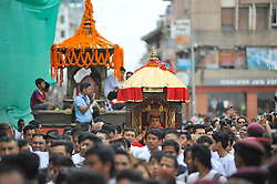 September 15, 2016 - Kathmandu, NE, Nepal - Devotees carrying God 'Ganesh' for the chariot pulling festival on the third day of Indra Jatra Festival celebrated at Basantapur Durbar Square, Kathmandu, Nepal on Thursday, September 15, 2016. Devotees celebrated the god of rain 'Indra' for 8 days in Kathmandu. (Credit Image: © Narayan Maharjan/NurPhoto via ZUMA Press)
