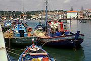 PORTUGAL, ALGARVE, SOUTH COAST Tavira, pleasant fishing port on the Gil�no River with fishing boats