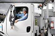 Portrait of a utility worker sitting in his truck. The image is part of an employee pride campaign.