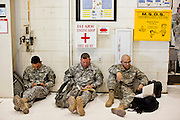 16 JUNE 2010 - PHOENIX, AZ: Spc. Gerardo Martinez LEFT, SSgt Terry Stallings and Sgt Rene Sanchez wait to greet their families after returning from Iraq at the 161st Air Refueling Wing hangar at Sky Harbor Airport in Phoenix Wednesday. Members of the 3666th Maintenance Company of the Arizona Army National Guard returned to Phoenix Wednesday after serving in Iraq.    PHOTO BY JACK KURTZ