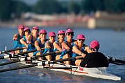 Womens eights rowing team in action.