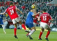 Fotball<br /> Premier League 2004/05<br /> Charlton v Everton<br /> 28. desember 2004<br /> Foto: Digitalsport<br /> NORWAY ONLY<br /> Everton's Tim Cahill gets inbetween Charlton Athletic's Jon Fortune (l), Luke Young (rear) and Talal El Karkouri (r) to get a header in on goal