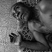 Suffering from asbestosis, 66-year-old Mangabhai Patel is seen on a bed gasping for air at his relatives home in Ahmedabad, India where he is living. He worked for 37 years at the Ahmedabad Electric Company (AEC) and was exposed to asbestos and has been diagnosed with Asbestosis. He is constantly gasping for air due to his severely damaged lungs. He can only walk short distances before he is nearly incapacitated from the disease which causes difficulty in breathing. After 10 years of trying to get compensation, an out of court settlement of approximately $4000.00 dollars will be paid to him in compensation.