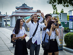 September 11, 2017 - Bangkok, Bangkok, Thailand - Thai university students photograph the main entrance to Wat Arun, also called the ''Temple of the Dawn.'' Renovations are nearly finished at Wat Arun on the Thonburi side of the Chao Phraya River in Bangkok. Wat Arun is famous for its Khmer style main ''prang'' (chedi). It was rebuilt in the time of Rama II. (Credit Image: © Sean Edison via ZUMA Wire)