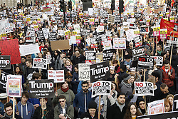 © Licensed to London News Pictures. 04/02/2017. London, UK. Demonstrators gather outside Downing Street as they march against U.S President Donald Trump's Executive Order banning refugees and immigrants from a number of Muslim-majority countries. Protestors join campaign groups including Stop the War, Stand up to Racism, Muslim Association of Britain, in a march from the U.S Embassy in London to Downing Street. Photo credit: Peter Macdiarmid/LNP