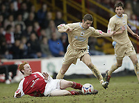 Photo: Aidan Ellis.<br /> Rotherham United v Bristol City. Coca Cola League 1. 25/03/2006.<br /> Rotherham's Gregor Robertson tackles City's Alex Russell