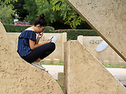 Young female teen relaxing in an urban park