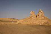 Rock formations eroded by wind over millions of years at al-Galamun, near Dahkla Oasis, Western Desert, Egypt. The Western Desert covers an area of some 700,000 km2, thereby accounting for around two-thirds of Egypt's total land area. Dakhla Oasis is one of the seven oases of Egypt's Western Desert (part of the Libyan Desert). It lies in the New Valley Governorate, 350 km (220 mi.) and measures approximately 80 km (50 mi) from east to west and 25 km (16 mi) from north to south.