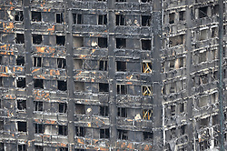 © Licensed to London News Pictures. 23/06/2017. London, UK. Wooden supports with support scaffolding can be seen on three floors following work by firefighters.  The burned out Nine days on, police have reported that the Grenfell Tower fire in west London started in a fridge-freezer, and outside cladding and insulation failed safety tests. Photo credit : Stephen Chung/LNP