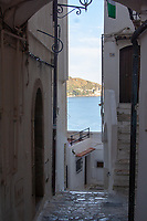 view of the sea and of the coast fom an alley of The city center of Sperlonga in Italy