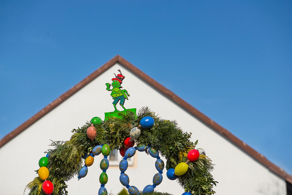 House decorated with wreath and Easter eggs in festival of Easter