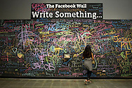 Shreya Angajala, 10, writes on one of the many chalkboards around the new Facebook headquarters in Menlo Park, CA, as she waits for her father, a Facebook employee, to get off work on Friday, April 20, 2012. Photo by Erin Lubin