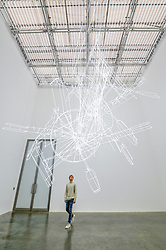 """© Licensed to London News Pictures. 06/02/2020. LONDON, UK. A staff member views """"fig. (0)"""", 2020, by Cerith Wyn Evans. Preview of """"No realm of thought... No field of vision"""" by Cerith Wyn Evans at the White Cube gallery in Bermondsey.  The exhibition runs 7 February to 19 April 2020.  The show comprises installations, sculpture and painting.  Photo credit: Stephen Chung/LNP"""
