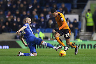 Wolverhampton Wanderers midfielder Jordan Graham (24) beats Brighton defender, Bruno Saltor (2) in a tackle during the Sky Bet Championship match between Brighton and Hove Albion and Wolverhampton Wanderers at the American Express Community Stadium, Brighton and Hove, England on 1 January 2016. Photo by Phil Duncan.