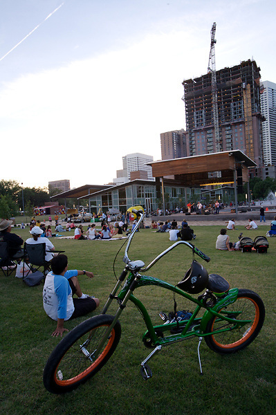 Stock photo of a boy with his bicycle watching a band playing on stage