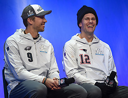 January 29, 2018 - Minneapolis, Minnesota, U.S - New England Patriots quarterback TOM BRADY, right, sits next to Philadelphia Eagles quarterback NICK FOLES at Super Bowl LII Opening Night at the Xcel Energy Center in St. Paul, Minnesota. (Credit Image: © Craig Lassig via ZUMA Wire)