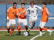 Middletown, New York - A Webster Schroeder High School soccer player, in white, leaps between Hicksville players during the New York State Class AA boys' soccer championship game at Faller Field on Nov. 20, 2011.