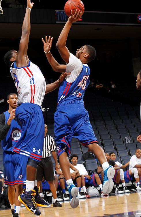 Malcolm Hill participates in a basketball camp in Charlottesville, Va. (Photo/Andrew Shurtleff)