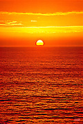 The sun dropped below storm clouds off Big Sur California and, for only a brief moment, illuminated the Pacific Ocean in blazing color to mark the beginning of Halloween night.