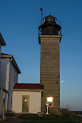 Beavertail Lighthouse in Jamestown, Rhode Island, at sunset. The first  lighthouse was built on this spot in 1749; the present lighthouse dates to 1856.