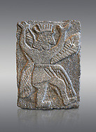 Hittite relief sculpted orthostat panel od a god from Tell Halaf, ancient Guzana, Syria, iX cent BC, Louvre Museum. Cat No AO 11073. Grey background