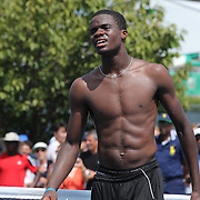 Francis Tiafoe, USA, after his astonishing win over number one seed Andrey Rublev, Russia, in the Junior Boys' Singles Quarterfinals. Tiafoe blew a 6-1, 5-1 lead to win the third set 6-4 in sweltering heat during the US Open Tennis Tournament, Flushing, New York, USA. 5th September 2014. Photo Tim Clayton