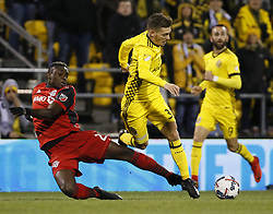 November 21, 2017 - Columbus, OH, USA - Toronto FC defender Chris Mavinga (23) trips up Columbus Crew forward Pedro Santos (32) during the first half of the first leg of the MLS Eastern Conference finals at MAPFRE Stadium in Columbus, Ohio, on Tuesday, Nov. 21, 2017. After a scoreless draw, the teams move to Toronto for the final leg on November 29. (Credit Image: © Adam Cairns/TNS via ZUMA Wire)