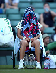 Elena-Gabriela Ruse under a towel on her seat during a change of ends on day One of the Wimbledon Championships at the All England Lawn Tennis and Croquet Club, Wimbledon.