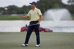 February 25, 2018 - Palm Beach Gardens, Florida, U.S. - Justin Thomas celebrates his tournament-winning putt on the first playoff hole during the final round of the 2018 Honda Classic at PGA National Resort and Spa in Palm Beach Gardens, Fla., on Sunday, February 25, 2018. (Credit Image: © Andres Leiva/The Palm Beach Post via ZUMA Wire)